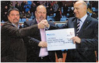 Steven Bond and Garry Davies Presenting a Cheque for £11,000 to Acorns